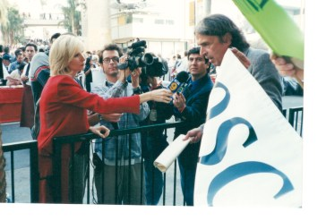 """John Walsh Speaking to media on Hollywood Blvd at opening of the (then) Kodak Theater in 2000 - leading protest """"Oscar on welfare"""" to object to taxpayers funding the theater for the use of the Cirque du Soleil and other private entities."""