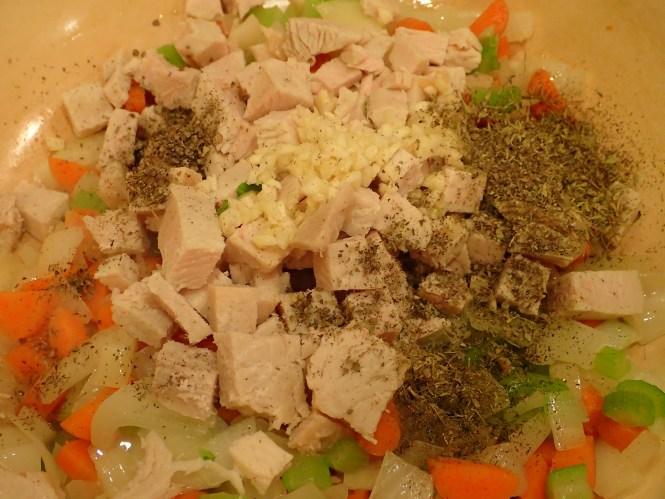 Add herbs and garlic