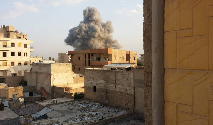 Smoke rises after air strikes by Syrian army warplanes on the ISIS-held northern city of Raqqa