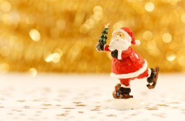 figurine-of-santa-claus-holding-xmas-tree