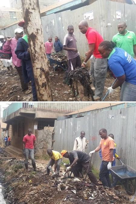 Daniel Juma, Director Ejecutivo de GPF-Kenia con jóvenes de Kariobangi sacando la basura de las zanjas durante el Día de Limpieza a lo largo de la ciudad.