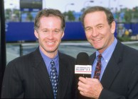 Commentators Patrick McEnroe and Cliff Drysdale are shown posing for a promotional photo while working on location at a tennis match back on February 6, 2000.