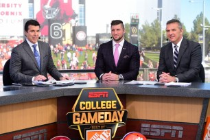 Glendale, AZ - January 11, 2016 - University of Phoenix Stadium: Rece Davis, Tim Tebow and Coach Urban Meyer of the Ohio State University Buckeyes on the onsite set of College GameDay during Pre-game coverage of the 2016 CFP National Championship (Photo by Phil Ellsworth / ESPN Images)