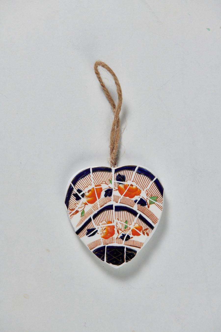 Coeur mosaïque motif orange et noir