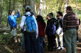 Matthew Aiello-Lammens teaches local high school students about plant identification