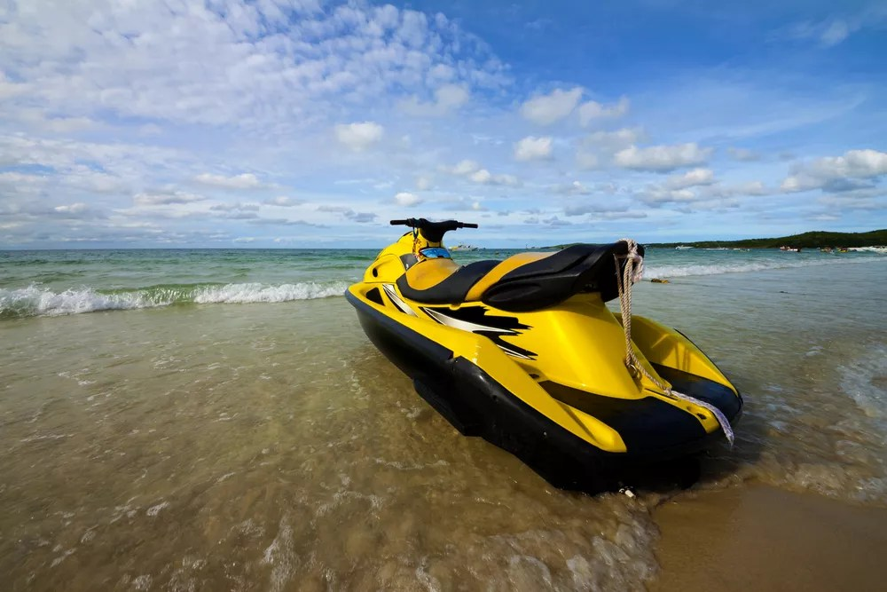 Jet ski sitting on beach
