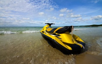 Jet ski sitting on beach