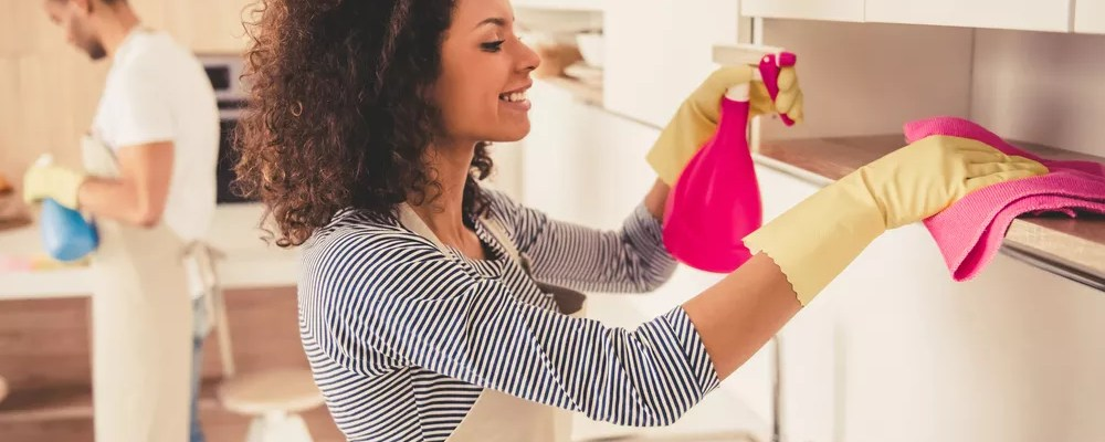 Woman cleaning kitchen for spring cleaning