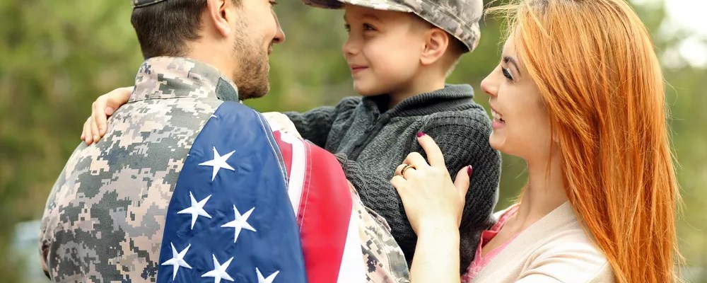 Military servicemember with wife and young son