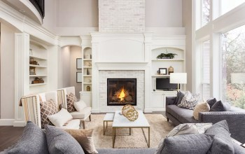 Luxury living room with fireplace and large windows