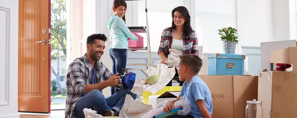 Young family packing up household items for move