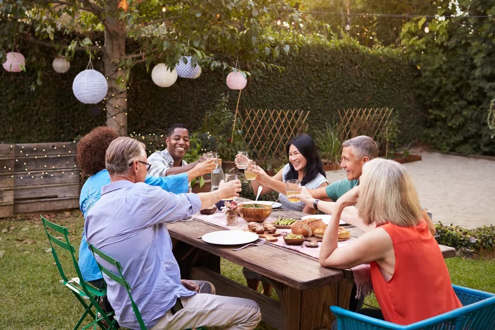 Group of neighbors at a backyard dinner party