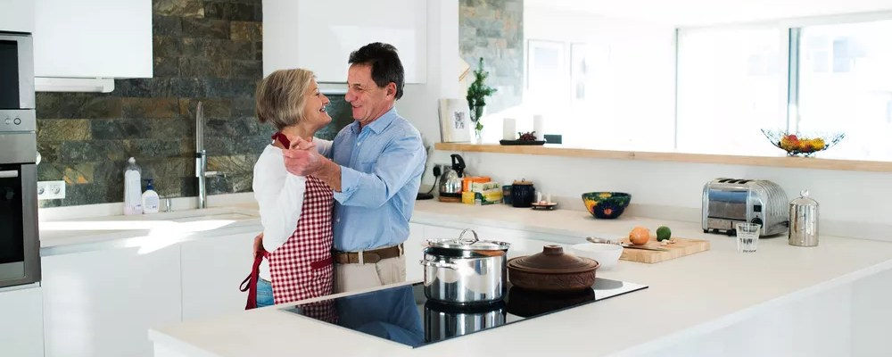 Mature couple in condo kitchen
