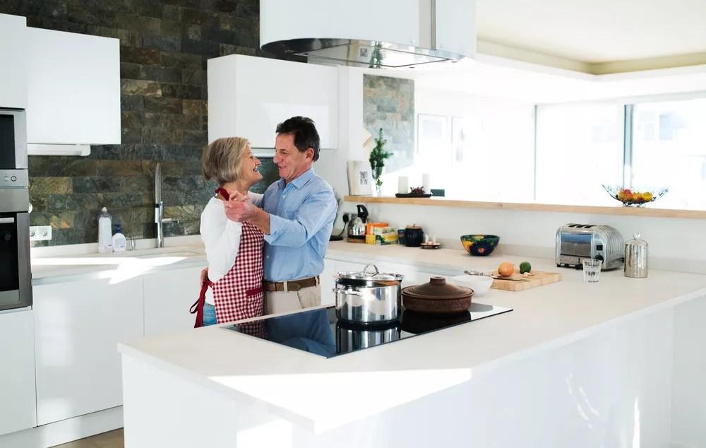 Mature couple in condo kitchen
