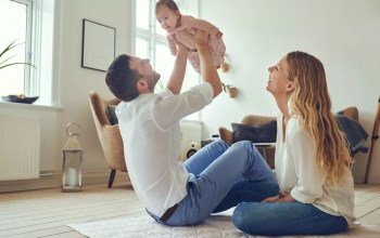 Young parents with baby in small apartment