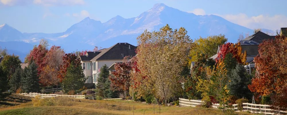 Denver neighborhood next to golf course with mountains in the background
