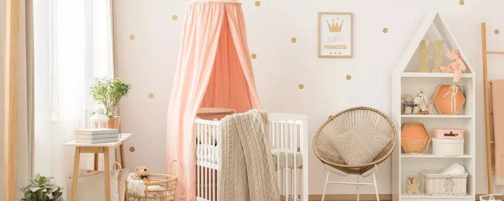 Baby room with white crib pink canopy.