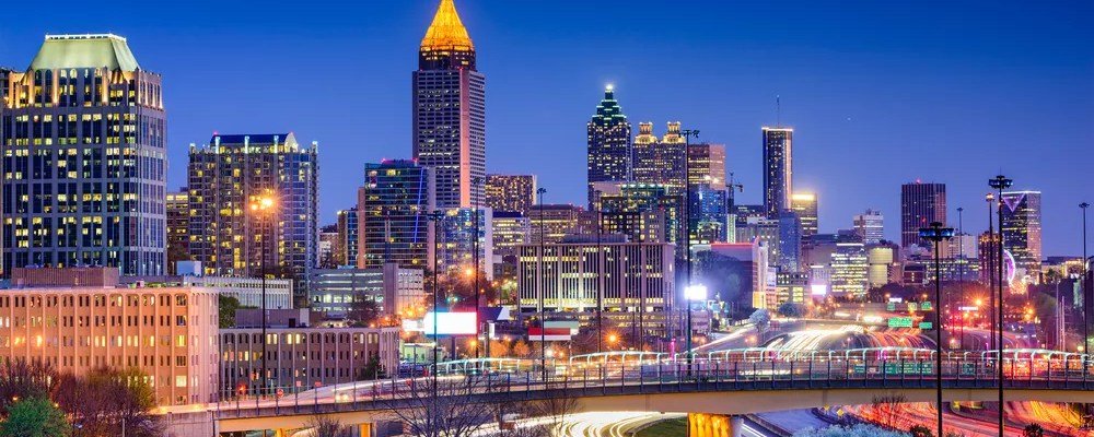 Skyline of Downtown Atlanta at Night. Featured Image