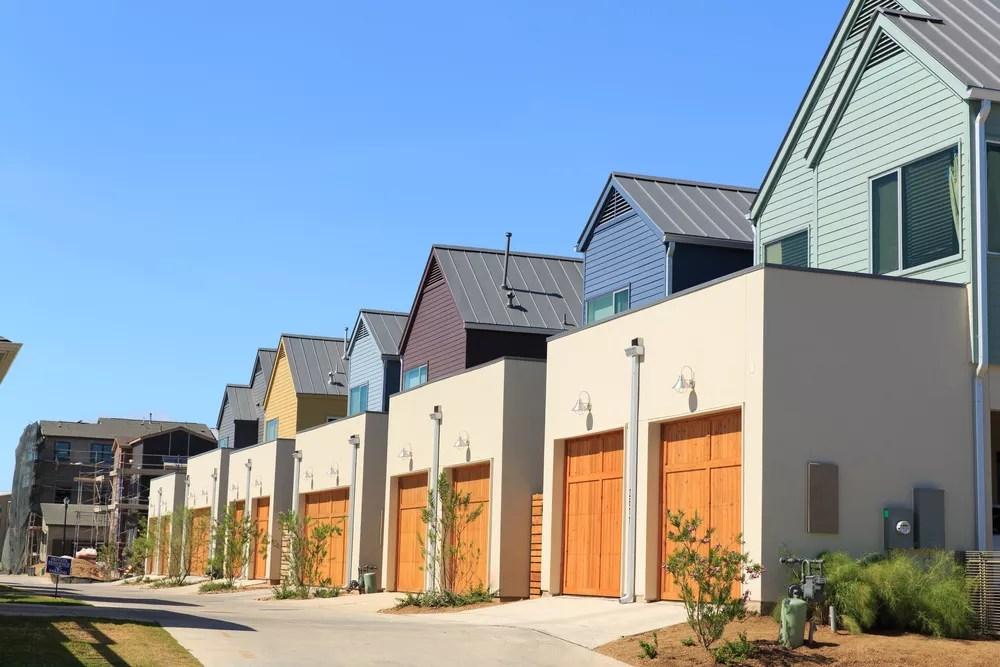 Row of Homes with Orange Garage Doors in Austin, TX