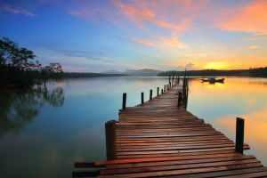 A lake pier at sunset