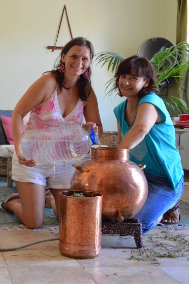 Ildiko and Christina fill up the cauldron with spring water, 2017