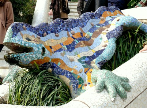 The salamander on the main stairs has become one of the symbols of Gaudi's work. It is a legendary animal often associated with fire and it can be also interpreted as dragon from biblical sources (remember the medieval story of Saint George and Dragon?). Sometimes it is connected with the crocodile from the coat of arms of City of Nimes where Gaudí studied. It also has a functional purpose as it is the outlet for the tank situated below the colonnade.