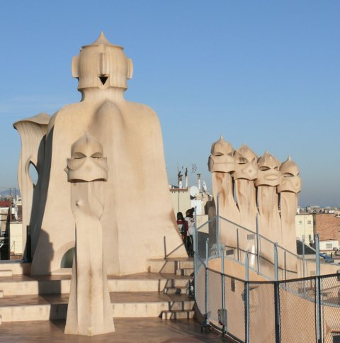 "On the roof of Casa Mila' Gaudí created a ""garden of sculptures"" by decorating chimneys and air shafts with stone statues. They resemble silent warriors guarding the piece and serenity of this magic house."