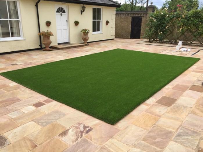 Fake grass lawn in Essex courtyard Garden