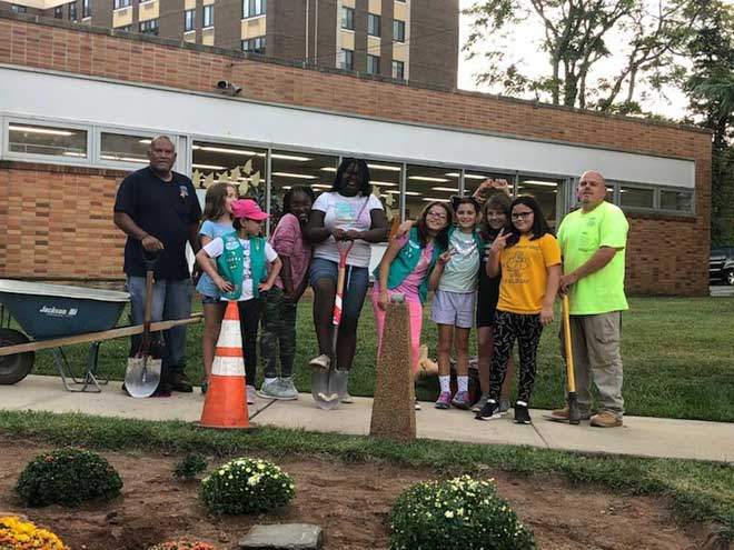 WO Girl Scouts take action, plant garden outside library