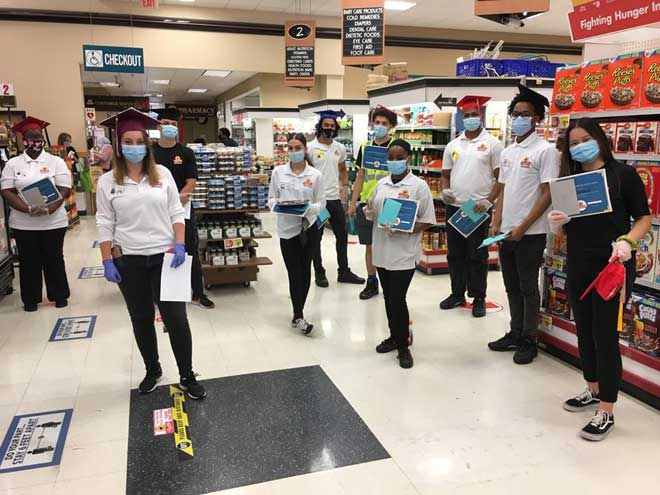 Area grocery store celebrates its employee graduates