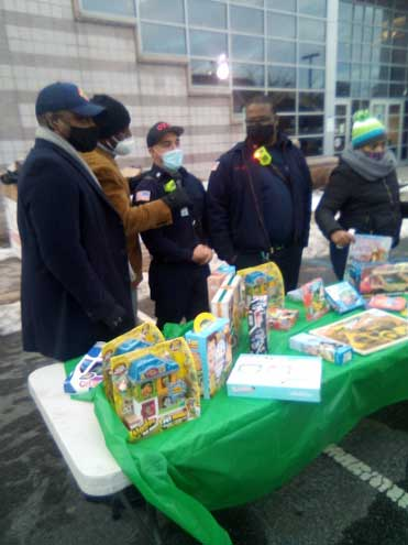 Warren joins with Orange Police and Fire depts. for toy giveaway