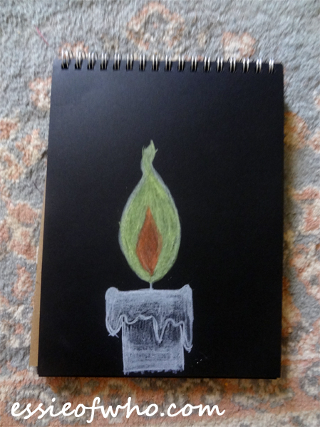 black paper sketch candle