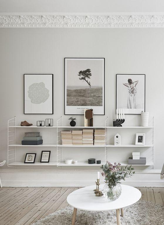 decorar las paredes distancia entre cuadros