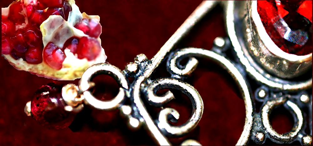 Garnet Legends Header with Garnet Pendant and pomegranate