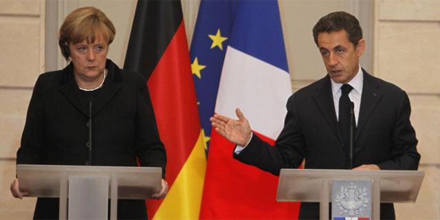 Angela Merkel y Nicolas Sarkozy en la comparecencia de prensa tras su encuentro. | AP