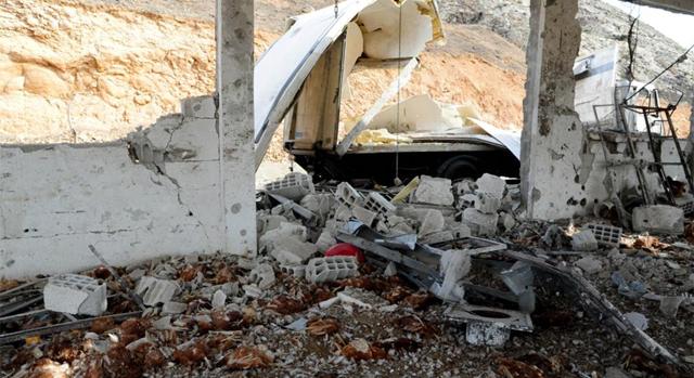 Desperfectos causados por uno de los ataques de Israel, según la agencia SANA. | Afp