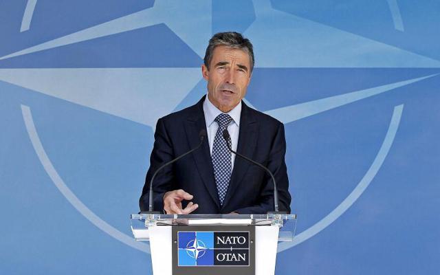 El secretario general de la OTAN, Rasmussen, en una rueda de prensa en Bruselas. | Reuters