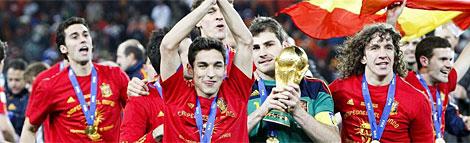Arbeloa, Navas, Casillas y Puyol, con la Copa del Mundo de 2010.