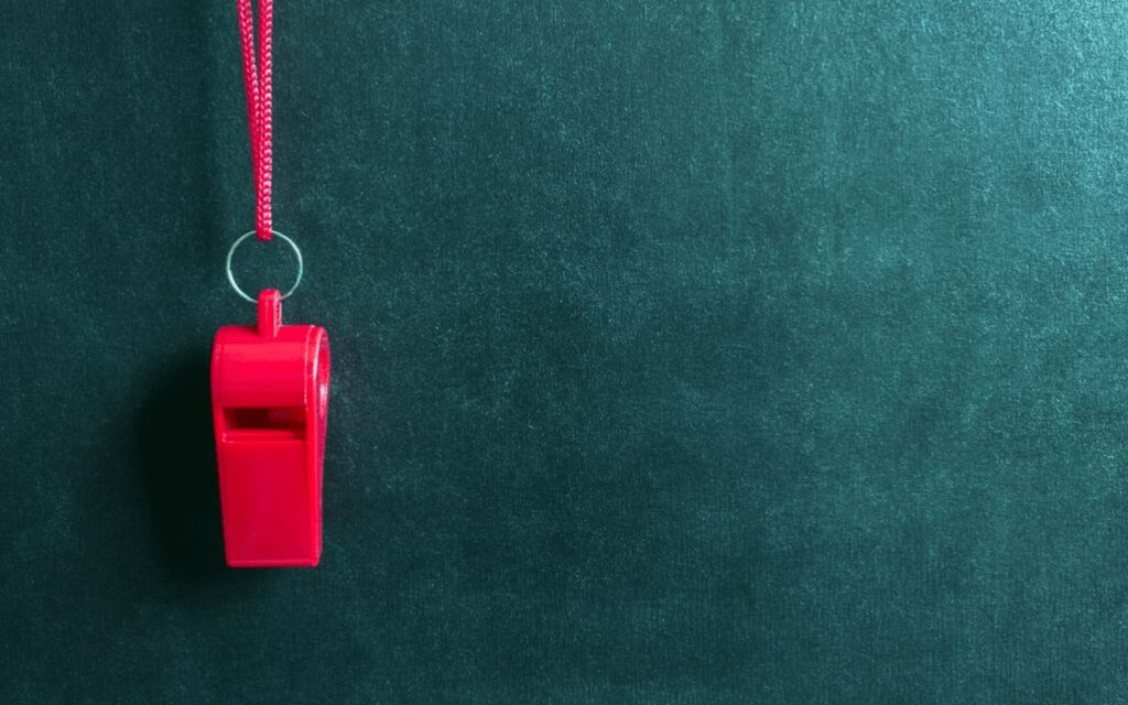 The Problem of Legalism in Christianity - Red Whistle on green background
