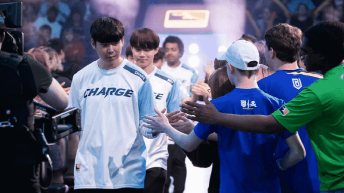 The Guangzhou Charge Overwatch League team high fiving fans in the Overwatch League arena