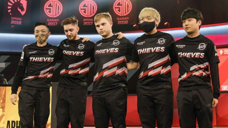 The 100 Thieves LCS roster of Ssumday, Closer, Abbedagge, Huhi and FBI stand together after a victory on the LCS stage.