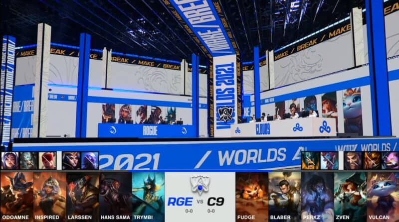 A screenshot from the 2021 World Championship Main Event Group Stage broadcast, showing the champion drafts between Rogue and Cloud9 with a shot of Rogue and C9 on the Worlds 2021 stage above.