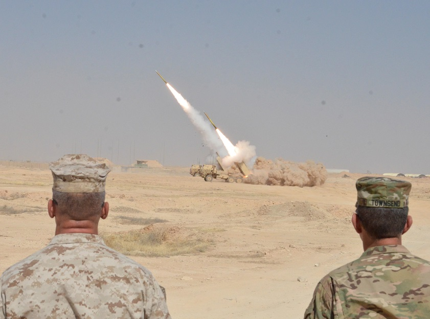 Leaders watch HIMARS launch toward ISIL