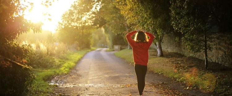 woman walking on a back road