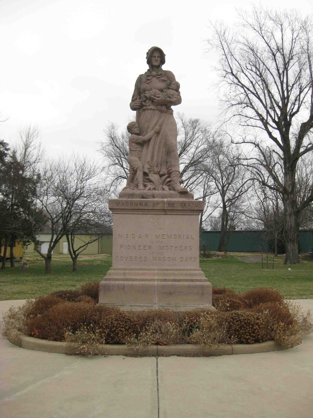 madonna of the trail in council grove, kansas