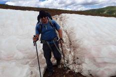 david hiking through the snow