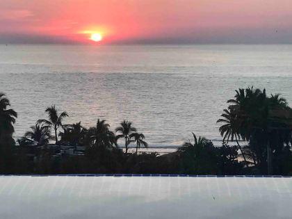 Infinity pool ocean sunset