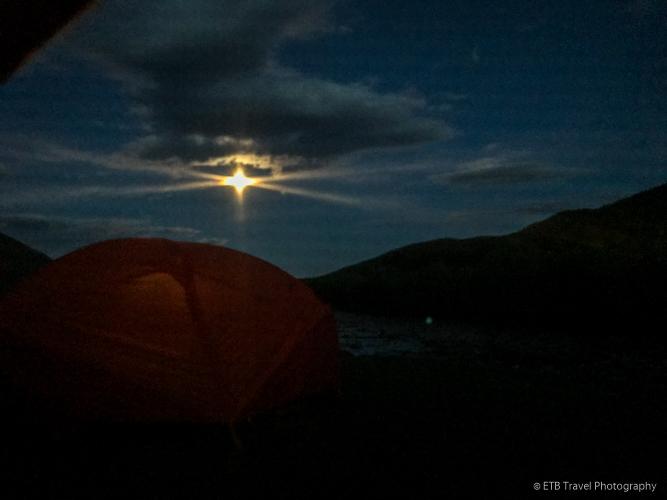 moon photo taken through netting of tent