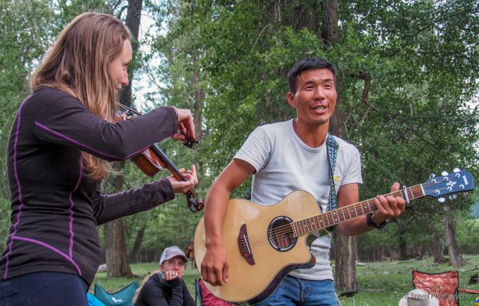 Emma and Boynaa playing musical instruments