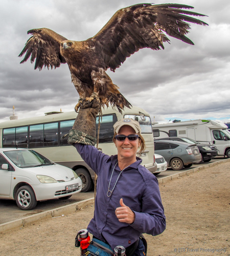 holding a golden eagle in mongolia